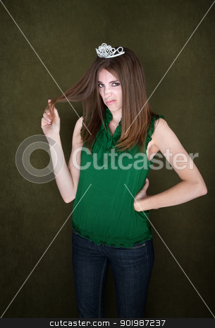 Unimpressed Woman Wearing a Tiara stock photo, Woman with small crown sneers and twirls her hair by Scott Griessel