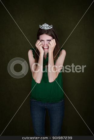 Woman With Crown Cries stock photo, Young Caucasian woman with a tiara weeps by Scott Griessel