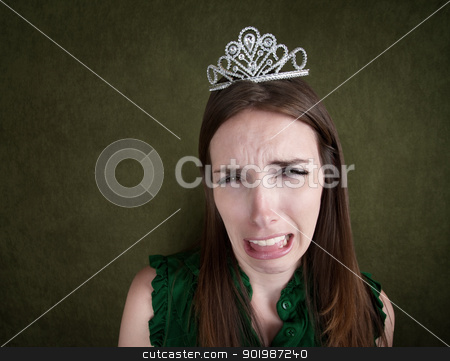 Weeping Woman In a Tiara stock photo, Crying young Caucasian woman with a tiara by Scott Griessel