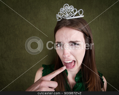 Young Queen Makes a Gagging Gesture stock photo, Disgusted Young Woman with a crown tiara and gagging gesture by Scott Griessel