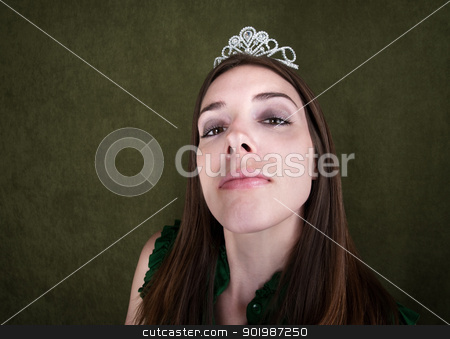 Proud Homecoming Queen stock photo, Proud woman with tiara on green background by Scott Griessel