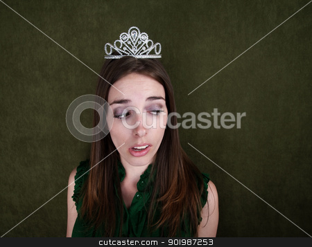Disinterested Homecoming Queen stock photo, Young Disinterested Homecoming Queen on green background by Scott Griessel