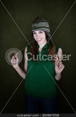 Happy Young Woman stock photo, Happy young Caucasian woman pulling the strings of cap by Scott Griessel