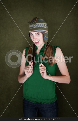 Happy Young Woman with Knit Cap stock photo, Happy Young Woman on green background with Knit Cap by Scott Griessel