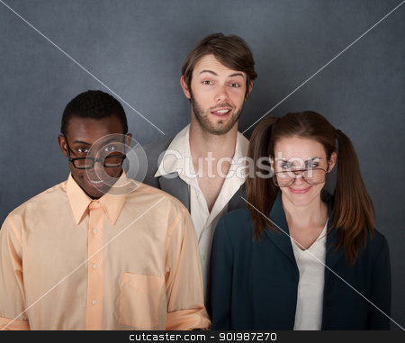 Thre Nerds Smiling stock photo, Mixed group of geeks on gray background smiling by Scott Griessel