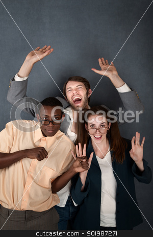 Three Nerds Dance stock photo, Two male and one female nerd celebrate and dance by Scott Griessel
