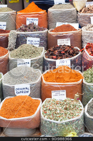 Spices and Herbs in Market stock photo, Market stall in Turgutreis (Turkey) offering a variety of spices and herbs including saffron, lavender, oregano, paprika, sundried tomato, cinnamon etc. by Brigida Soriano