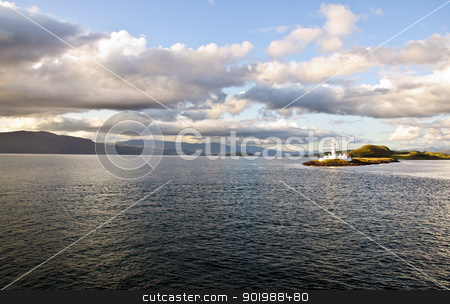 Scotland -  Eilean Musdile Lighthouse stock photo, The Eilean Musdile lighthouse set against the mountains of South West Scotland by SRSImages