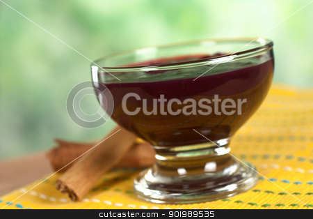Peruvian Dessert Called Mazamorra Morada stock photo, Popular Peruvian dessert called Mazamorra Morada (made out of purple corn) with cinnamon sticks on the side (Selective Focus, Focus on the front of the bowl) by Ildi Papp
