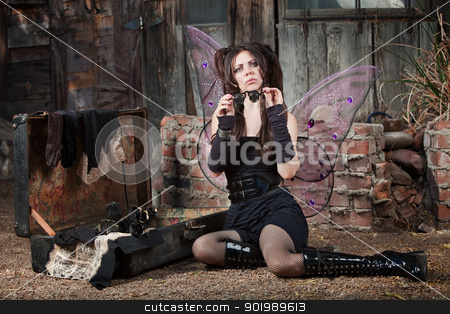 Fairy Holds Loupe stock photo, Cute Caucasian fairy holds loupe  by Scott Griessel