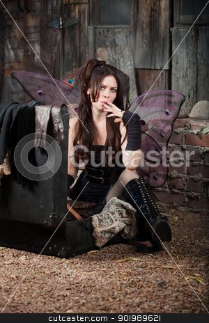Fairy Smokes Cigar stock photo, Faery girl sitting on ground smokes cigar by Scott Griessel