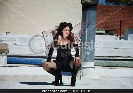 Faery on Roof stock photo, Annoyed fairy squats outdoors in black outfit by Scott Griessel