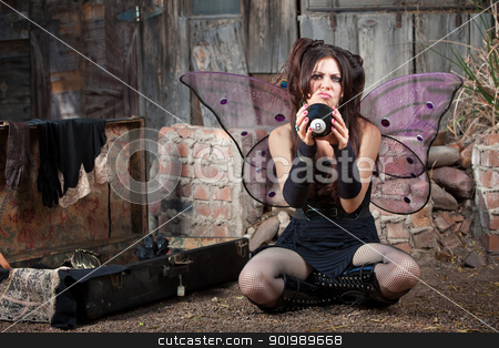 Unhappy Fairy With Eight Ball stock photo, Unhappy Caucasian fairy relaxing on ground with magic eight ball by Scott Griessel