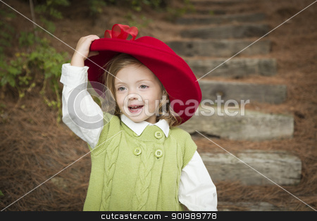 Adorable Child Girl with Red Hat Playing Outside stock photo, Happy Adorable Child Girl with Red Hat Playing Outside. by Andy Dean