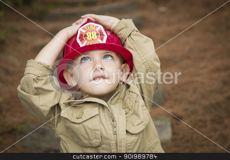 Adorable Child Boy with Fireman Hat Playing Outside stock photo, Happy Adorable Child Boy with Fireman Hat Playing Outside. by Andy Dean