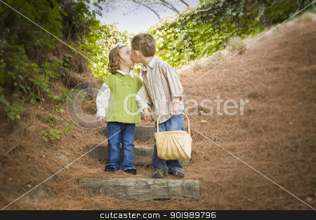 Two Children with Basket Kissing Outside on Steps stock photo, Adorable Brother and Sister Children with Basket Kissing Outside. by Andy Dean