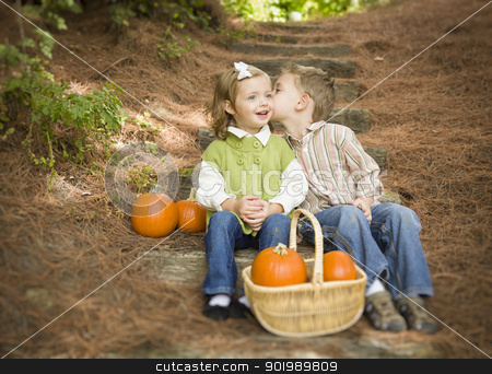 Brother and Sister Children on Wood Steps with Pumpkins Whisperi stock photo, Adorable Brother and Sister Children Sitting on Wood Steps with Pumpkins Whispering Secrets or Kissing Cheek. by Andy Dean