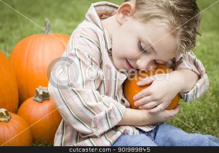 Cute Young Child Boy Enjoying the Pumpkin Patch. stock photo, Adorable Young Child Boy Enjoying the Pumpkins at the Pumpkin Patch. by Andy Dean
