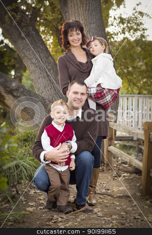 Young Attractive Parents and Children Portrait in Park stock photo, Young Attractive Parents and Children Portrait Outside in the Park. by Andy Dean
