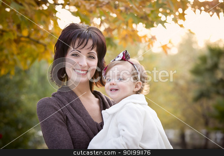 Attractive Mother and Daughter Portrait Outside stock photo, Attractive Mother and Daughter Portrait Outside at the Park. by Andy Dean