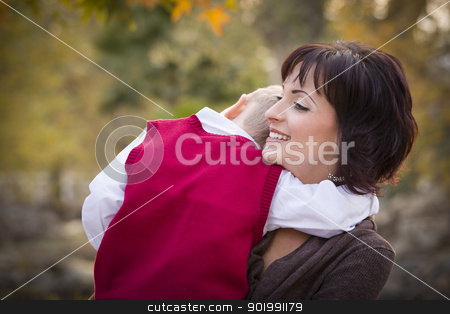 Attractive Mother and Son Portrait Outside stock photo, Attractive Mother and Cute Son Portrait Outside at the Park. by Andy Dean