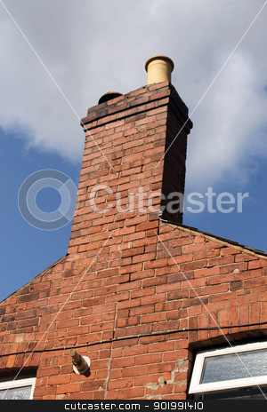 Chimney of old brick house stock photo, Chimney of old brick house or home with blue sky and cloudscape background.  by Martin Crowdy