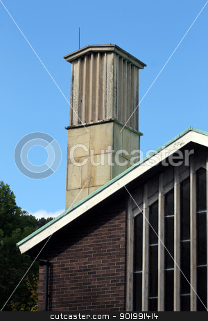 Chimney on modern crematorium building stock photo, Chimney on modern crematorium building with blue sky background. by Martin Crowdy