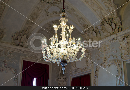 Old, elegant chandelier stock photo, Classic crystal chandelier hanging from decorated ceiling by Stefano Cavoretto