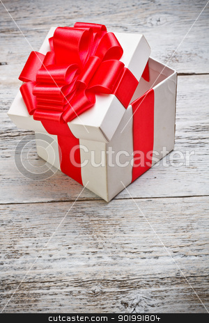 Open present box stock photo, Open present box on wooden background  by Grafvision
