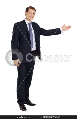 Businessman pointing stock photo, Photo of a handsome young businessman pointing to something.