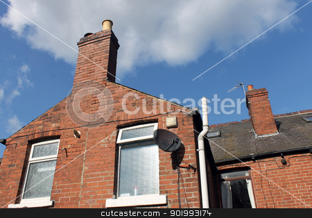 House chimney and satellite dish stock photo, Old brick house or home with chimney and satellite dish, blue sky and cloudscape background.  by Martin Crowdy