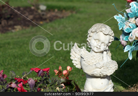 Memorial angel statue in cemetery stock photo, Memorial angel statue in cemetery next to blooming flowers. by Martin Crowdy