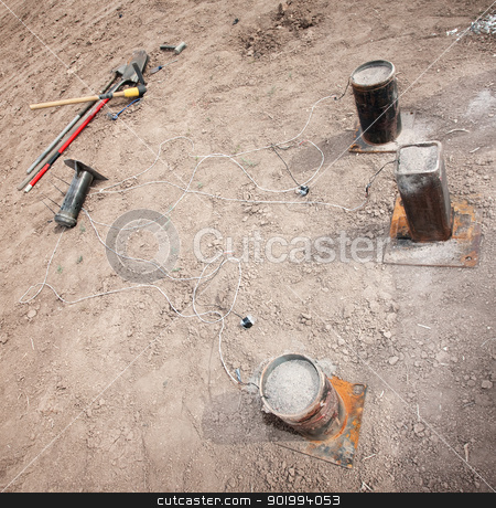 Filled Explosive Mortars stock photo, Set of explosive mortars and tools in desert by Scott Griessel