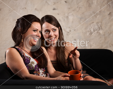 Giggling Women Pointing stock photo, Giggling European women looking ahead and pointing by Scott Griessel