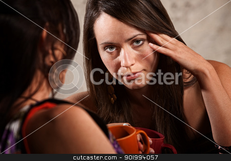 Worried or Bored Woman stock photo, Bored woman with fingers on head listening to friend by Scott Griessel