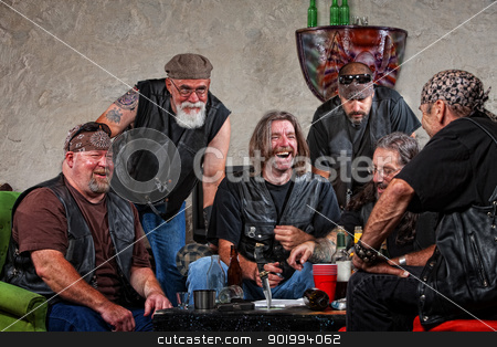 Laughing Gang Members stock photo, Six male biker gang members laughing with weapons on table by Scott Griessel
