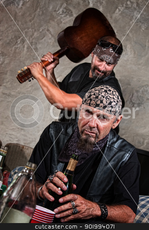 Man Hitting Someone with a Guitar stock photo, Gang member with guitar about to attack man sitting by Scott Griessel