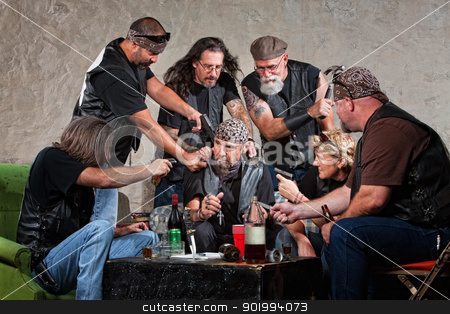 Gang Members Threaten a Man stock photo, Biker gang members threatening man in bandana by Scott Griessel
