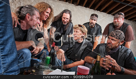 Gang Members Discuss Plans stock photo, Female biker gang leader discusses plans with members by Scott Griessel
