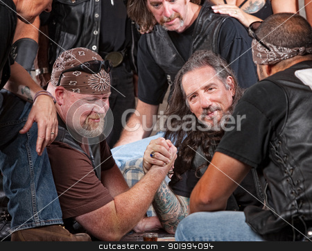Tough Men Arm Wrestling stock photo, Tough male gang members in arm wrestling match by Scott Griessel
