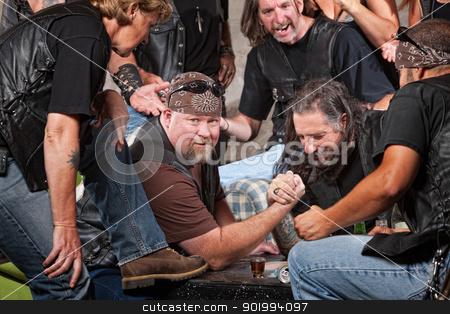 Man Winning Arm Wrestling Match stock photo, Big man in biker gang losing arm wrestling match by Scott Griessel