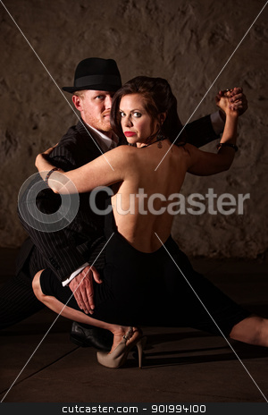 Tango Dancer Holding His Partner stock photo, 1920s style male tango dancer holding his dance partner by Scott Griessel