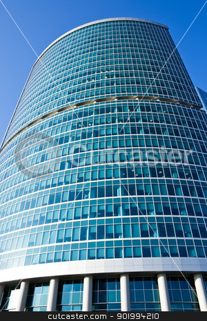 Skyscraper stock photo, High modern skyscraper under blue sky by Alexey Popov