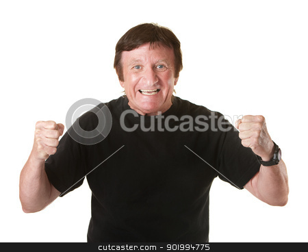 Excited Mature Man stock photo, Excited mature Caucasian man holds fists in the air by Scott Griessel
