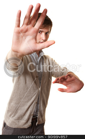 Teen Practes Martial Arts stock photo, Young Caucasian man practices Martial Arts over white background by Scott Griessel