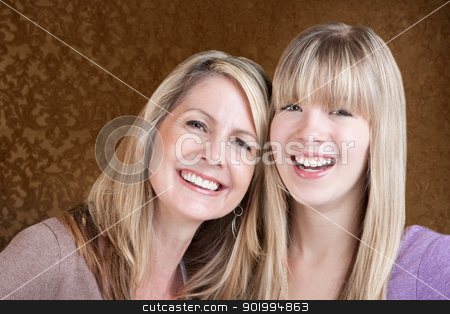 Happy Mom and Daughter stock photo, Happy Caucasian mom and daughter smile over green background by Scott Griessel