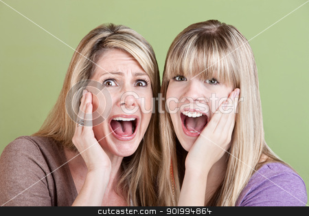 Screaming Ladies stock photo, Mother and daughter scream with hands on their faces by Scott Griessel