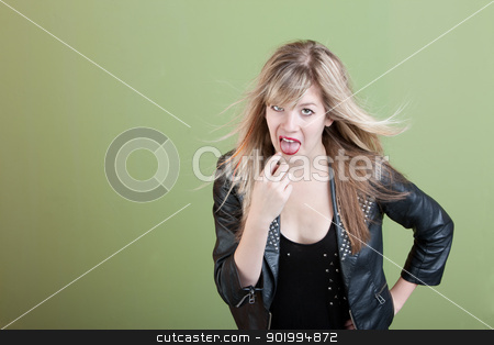 Woman Gestures She Needs To Throwup stock photo, Retro-styled young woman points finger in her mouth by Scott Griessel
