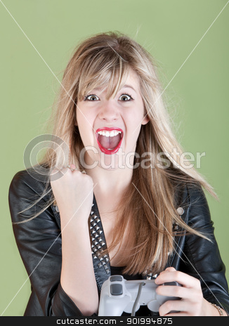 Happy Female Gamer stock photo, Young retro-styled Caucasian woman with video game controller pumps her fist  by Scott Griessel