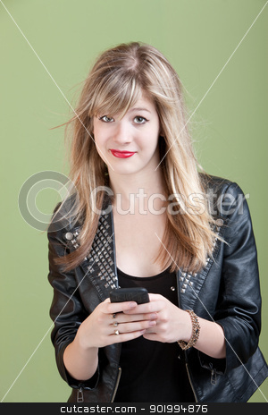 Girl With Messy Hair and Smartphone or Audio Device stock photo, Retro-styled young woman with messy hair and cellphone over green background by Scott Griessel